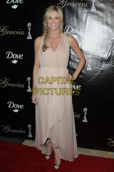 ERIN ANDREWS.The Gracie Awards presented at the Beverly Hilton Hotel. Beverly Hills, CA USA. .May 24th, 2011.full length beige dress hand on hip braid plait hair.CAP/CEL .©CelPh/Capital Pictures.