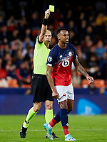 5th November 2019; Mestalla, Valencia, Spain; UEFA Champions League Football,Valencia versus Lille; Referee Sergei Karasev show a yellow card to Gabriel of Lille in minute 21' - Editorial Use