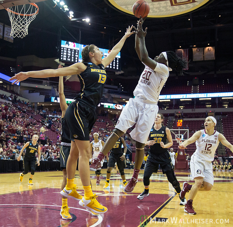 Florida State forward Shakayla Thomas shoots over Missouri forward Hannah Schuchts during the second half of a second-round game of the NCAA women's college basketball tournament in Tallahassee, Fla., Sunday, March 19, 2017. Florida State defeated Missouri 77-55. (AP Photo/Mark Wallheiser)