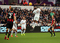 Andre Ayew of Swansea (10) heads the ball off target during the Barclays Premier League match between Swansea City and Bournemouth at the Liberty Stadium, Swansea on November 21 2015