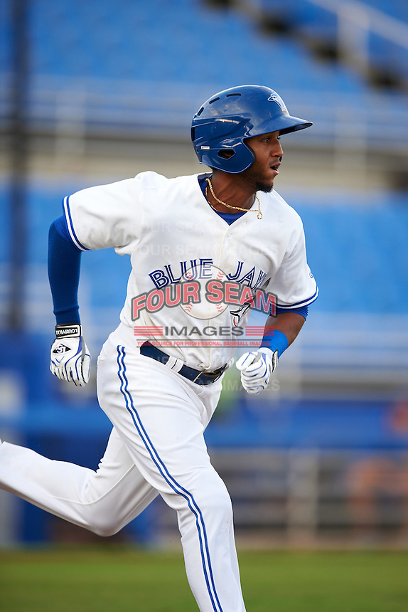 Dunedin Blue Jays shortstop Richard Urena (5) runs to first during a game against the Palm Beach Cardinals on April 15, 2016 at Florida Auto Exchange Stadium in Dunedin, Florida.  Dunedin defeated Palm Beach 8-7.  (Mike Janes/Four Seam Images)