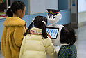 Children speak with SoftBank's humanoid robot Pepper on its first day as a new member of staff for the Keikyu Line railway at Haneda International Terminal station on November 28, 2015, Tokyo, Japan. Pepper is programmed to interact with Japanese and foreign commuters and to introduce Keiyu Line information. (Photo by Rodrigo Reyes Marin/AFLO)