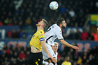 Alex Pearce of Millwall vies for possession with Borja Baston of Swansea City during the Sky Bet Championship match between Swansea City and Millwall at the Liberty Stadium in Swansea, Wales, UK. Saturday 23rd November 2019