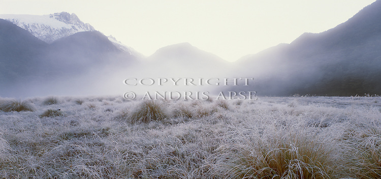 Frost covered river flats with fog and mist layers in the Upper Clarke Valley. Westland Region. New Zealand