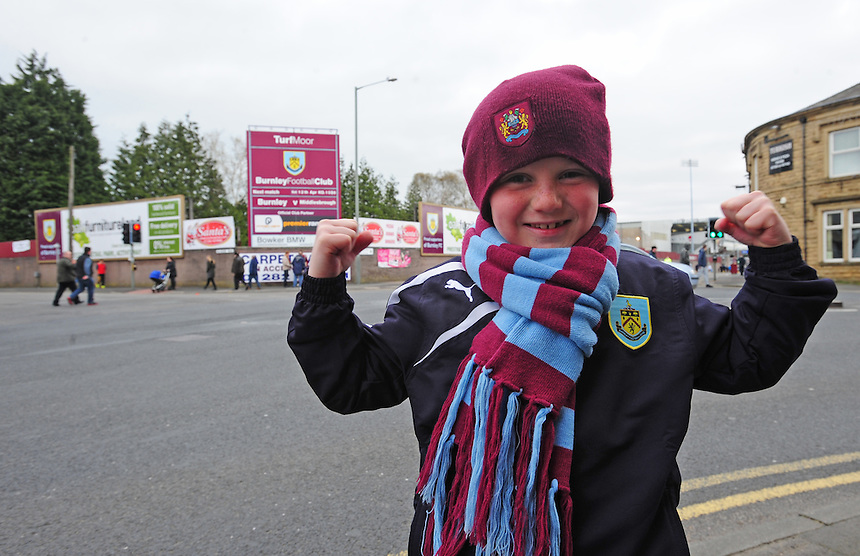 A Burnley fan outside the ground<br /> <br /> Photo by Chris Vaughan/CameraSport<br /> <br /> Football - The Football League Sky Bet Championship - Burnley v Middlesbrough - Saturday 12th April 2014 - Turf Moor - Burnley<br /> <br /> &copy; CameraSport - 43 Linden Ave. Countesthorpe. Leicester. England. LE8 5PG - Tel: +44 (0) 116 277 4147 - admin@camerasport.com - www.camerasport.com