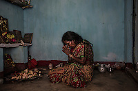 """Lokimoni Lohar, 45 years old, is the witch doctor of Mani Kwajar village, she is seen here performing the ritual to heal people's soul from the evil.  She claims to be able to heal people from evil spirits cast by witches and ghosts. According to her, witches gather in the surrounding fields every full moon night, where they dance in order to increase their powers. """"They have to be killed. If someone had done something bad to your wife or daughter, would you let her live?"""""""