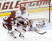James Marcou (UMass - 19), Brian Dumoulin (BC - 2), Parker Milner (BC - 35) - The Boston College Eagles defeated the University of Massachusetts-Amherst Minutemen 6-5 on Friday, March 12, 2010, in the opening game of their Hockey East Quarterfinal matchup at Conte Forum in Chestnut Hill, Massachusetts.