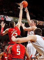 Virginia guard Joe Harris (12) shoots over Maryland center Alex Len (25) during the game Sunday in Charlottesville, VA. Virginia defeated Maryland in overtime 61-58. Photo/Andrew Shurtleff
