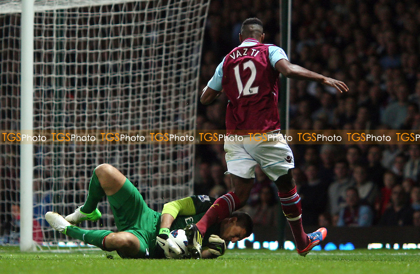Ricardo Vaz Te of West Ham leaves a foot in on Arsenal keeper Vito Mannone but it resulted in Vaz Te getting injured and having to leave the action - West Ham United vs Arsenal, Barclays Premier League at Upton Park, West Ham - 06/10/12 - MANDATORY CREDIT: Rob Newell/TGSPHOTO - Self billing applies where appropriate - 0845 094 6026 - contact@tgsphoto.co.uk - NO UNPAID USE.