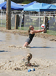 Blair Humphrey sets the ball during her mud volleyball match at the 2008 Cantaloupe  Festival.  Photo by Tom Smedes.