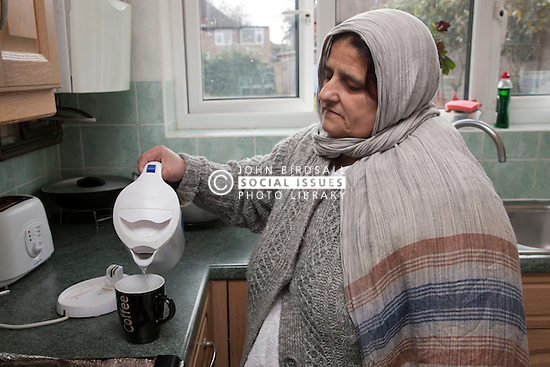 South Asian woman pouring a kettle.