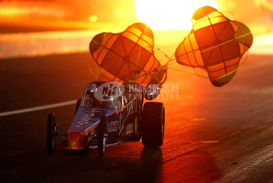 Aug. 30, 2013; Clermont, IN, USA: Fireworks explode as NHRA jet car driver John Bandimere III deploys his parachutes after a run during qualifying for the US Nationals at Lucas Oil Raceway. Mandatory Credit: Mark J. Rebilas-