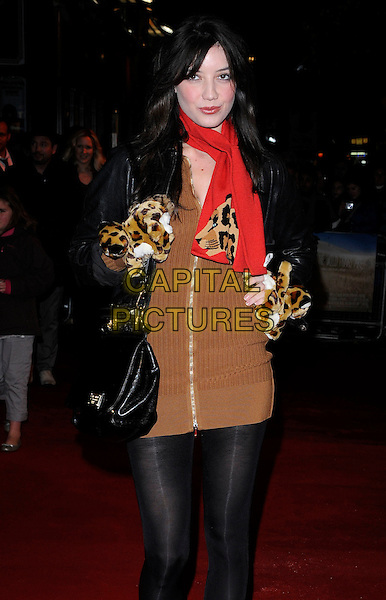 DAISY LOWE .At the UK Premiere of 'Where The Wild Things Are' at the Vue West End, Leicester Square, London, England, UK, December 2nd 2009..half length black tights brown zip up jumper sweater knitted dress red scarf leopard animal print gloves leather jacket bag tigers toys stuffed animals .CAP/CAN.©Can Nguyen/Capital Pictures.