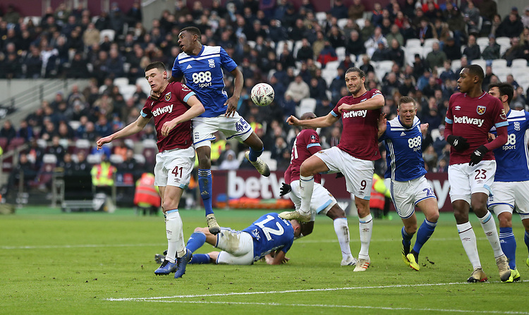 West Ham United's Declan Rice and Andy Carroll challenge Birmingham City's Wes Harding<br /> <br /> Photographer Rob Newell/CameraSport<br /> <br /> Emirates FA Cup Third Round - West Ham United v Birmingham City - Saturday 5th January 2019 - London Stadium - London<br />  <br /> World Copyright © 2019 CameraSport. All rights reserved. 43 Linden Ave. Countesthorpe. Leicester. England. LE8 5PG - Tel: +44 (0) 116 277 4147 - admin@camerasport.com - www.camerasport.com