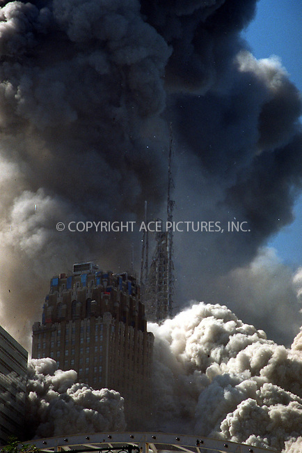 Two planes are directed and crashed by the terrorists into the Twin Towers of the World Trade Center in New York. September 11, 2001 Please byline: Alecsey Boldeskul/NY Photo Press.   ..*PAY-PER-USE*   *HIGHER RESOLUTION IS AVAILABLE*      ..NY Photo Press:  ..phone (646) 267-6913;   ..e-mail: info@nyphotopress.com