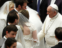 Papa Francesco saluta alcune coppie di sposi novelli al termine dell'udienza generale del mercoledi' in aula Paolo VI, Citta' del Vaticano, 21 gennaio 2015.<br /> Pope Francis greets some newlywed couples at the end of his weekly general audience in the Paul VI hall at the Vatican, 21 January 2015.<br /> UPDATE IMAGES PRESS/Isabella Bonotto<br /> <br /> STRICTLY ONLY FOR EDITORIAL USE