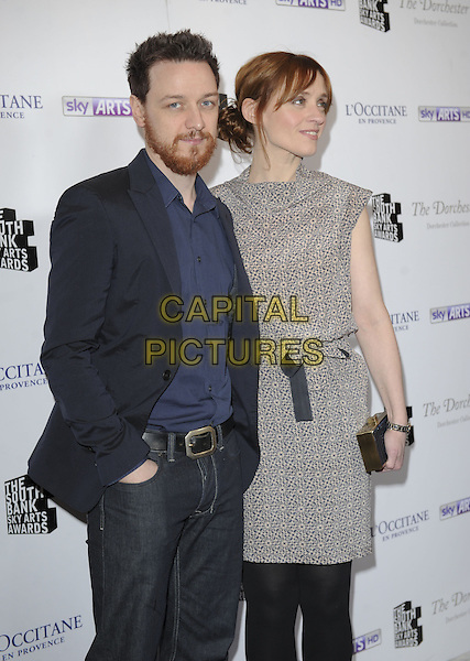 James McAvoy and Anne-Marie Duff.attended the South Bank Sky Arts Awards 2013, Dorchester Hotel, Park Lane, London, England..March 12th, 2013.half length black blue suit shirt grey gray dress side hand in pocket married husband wife pattern beard facial hair  jeans denim.CAP/ROS.©Steve Ross/Capital Pictures