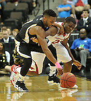 NWA Democrat-Gazette/Michael Woods --03/19/2015--w@NWAMICHAELW... University of Arkansas guard Manuael Watkins and Wofford guard Karl Cochran fight for the ball in the second half of Thursday nights 56-53 win against the Wofford Terriers in the 2015 NCAA basketball tournament at Jacksonville Veterans Memorial Arena in Jacksonville, Florida.