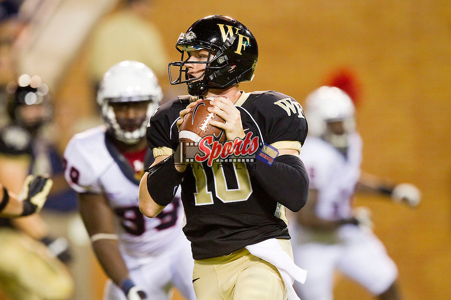 Tanner Price (10) of the Wake Forest Demon Deacons rolls out to his left looking to pass the ball against the Liberty Flames at BB&T Field on September 1, 2012 in Winston-Salem, North Carolina.  The Demon Deacons defeated the Flames 20-17.  (Brian Westerholt/Sports On Film)