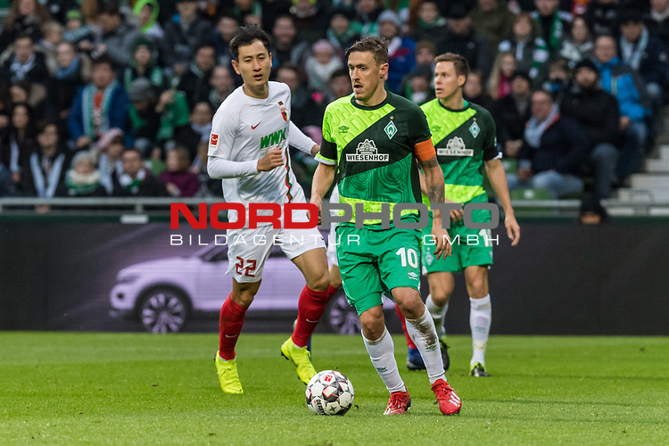 10.02.2019, Weserstadion, Bremen, GER, 1.FBL, Werder Bremen vs FC Augsburg<br /> <br /> DFL REGULATIONS PROHIBIT ANY USE OF PHOTOGRAPHS AS IMAGE SEQUENCES AND/OR QUASI-VIDEO.<br /> <br /> im Bild / picture shows<br /> Dong-Won Ji (FC Augsburg #22), Max Kruse (Werder Bremen #10), Niklas Moisander (Werder Bremen #18), <br /> <br /> Foto &copy; nordphoto / Ewert