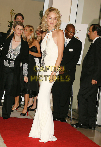 SHARON STONE.The 2006 BAFTA/LA Cunard Britannia Awards held at the Century Plaza Hotel, Los Angeles, California, USA..November 2nd, 2006.Ref: ADM/RE.full length white dress halterneck.www.capitalpictures.com.sales@capitalpictures.com.©Russ Elliot/AdMedia/Capital Pictures.