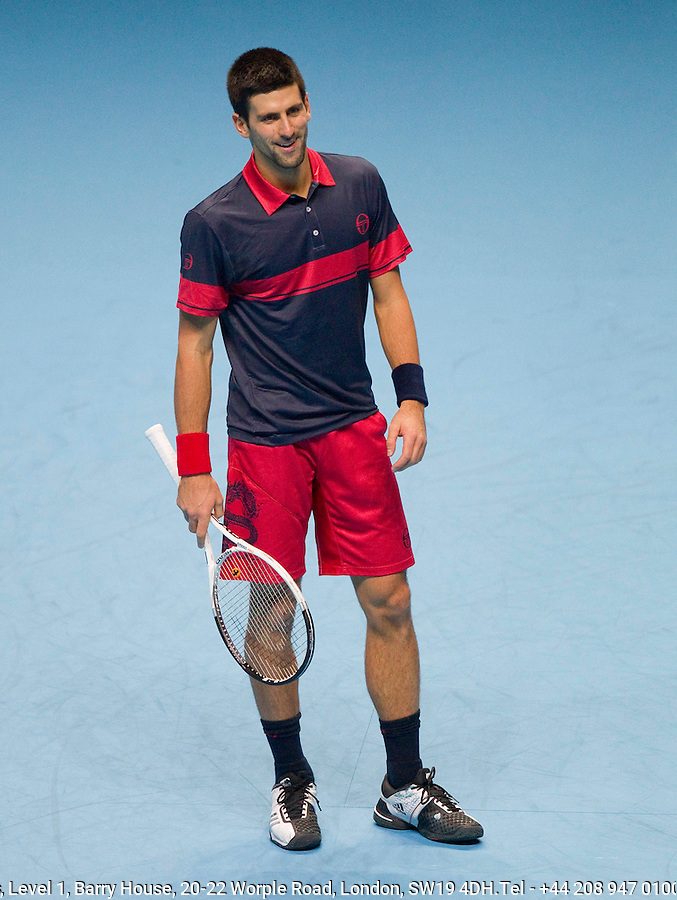 Novak Djokovic (SRB) (3) against Roger Federer (SUI) (2) in the semi-finals. Roger Federer beat Novak Djokovic 6-1 6-4..International Tennis - Barclays ATP World Tour Finals - O2 Arena - London - Day 7 - Sat 27 Nov 2010..© Frey - AMN Images, Level 1, Barry House, 20-22 Worple Road, London, SW19 4DH.Tel - +44 208 947 0100.Email - Mfrey@advantagemedianet.com.Web - www.amnimages.photshelter.com