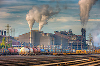 Steam rises from the smokestacks of the Arcelo Mittal steel mill in the Flats area of Cleveland, Ohio.  The mill is one of the most productive steel mills in the world, and is served by the adjacent CSX rail yard.