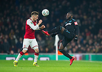Arsenal's Mathieu Debuchy and and West Ham's Arthur Masuaku during the Carabao Cup QF match between Arsenal and West Ham United at the Emirates Stadium, London, England on 19 December 2017. Photo by Andrew Aleksiejczuk / PRiME Media Images.