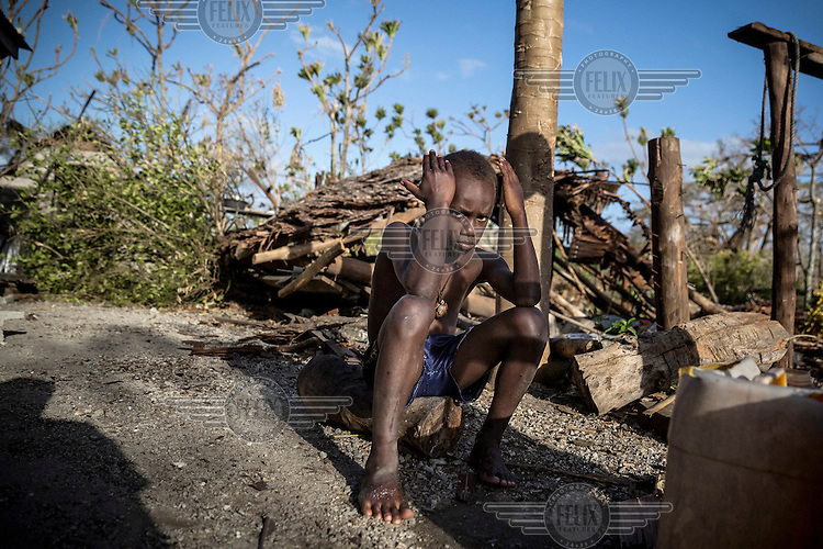 A boy sits in front of his destroyed house in Eton village. <br /> Cyclone Pam, a tropical storm that hit the Pacific island nation of Vanuatu on 13 March 2015, is considered one of the worst natural disasters to affect the country. Over 15 people died in the storm and winds up to 165 mph (270 km/h) caused widespread damage to houses and infrastructure.