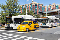 Westchester County Bee-line System buses serve passengers at the train station in Yonkers, New York.