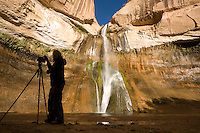 A group of photography students photograph early light on Calf Creek Falls, a three-mile trail in the Calf Creek Recreation Area near Grand Staircase-Escalante National Monument in southern Utah.