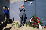 A Muslim Roma prays during a Holocaust memorial ceremony outside the gates of the old Lodz Ghetto. Many Roma were taken from here to the concentration camps and gas chambers. It is estimated that between half to one and a half million Roma were killed during the Holocaust by the Nazis. Lodz, Poland 2002