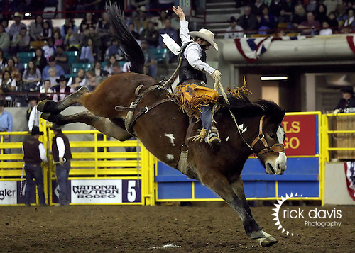 1/18/09--Photo by Rick Davis--PRCA cowboy Dean Wadsworth of Ozona, Texas scores a 72 point saddle bronc ride on the bronc Dual Motion during action at the 103rd National Western Stock Show and Rodeo in Denver, Colorado.