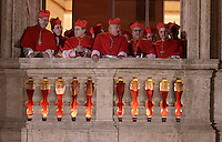 Cardinali affacciati da una delle logge laterali della Basilica di San Pietro, Citta' del Vaticano, 13 marzo 2013. Il Cardinale argentino Jorge Mario Bergoglio, che ha scelto il nome di Papa Francesco, e' il 266esimo Pontefice della Chiesa Cattolica Romana eletto dai 115 cardinali del Conclave..Cardinals at one of the lateral balconies of St. Peter's Basilica at the Vatican, 13 March 2013. Argentine Cardinal Jorge Mario Bergoglio, who chose the name of Pope Francis, is the 266th pontiff of the Roman Catholic Church elected by a Conclave of 115 cardinals. .UPDATE IMAGES PRESS/Riccardo De Luca.STRICTLY ONLY FOR EDITORIAL USE -STRICTLY FOR EDITORIAL USE ONLY-