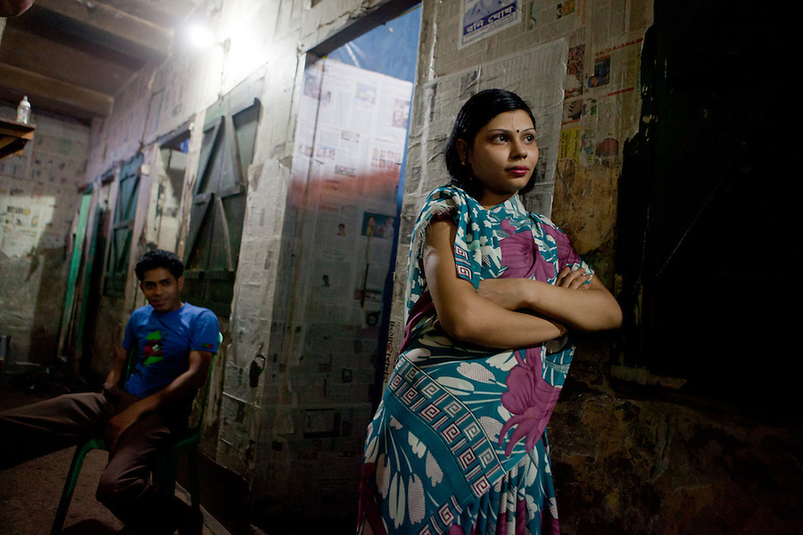 "Faridpur Brothel is the second to largest brothel in Bangladesh. (17 registered brothels in the country) 600+ girls live in a hidden neighboorhood accesible through one of the six alleyways, covered with small ragged curtains mimicking doors. Many girls are under aged - the ""legal"" age being 18. The chhukris wait during long periods of time for clients to walk past their rooms, the girls are forced to stake out their territory 24h/7 365 days a year. March 14, 2011. Gabriela Barnuevo, 2011. Gabriela Barnuevo"