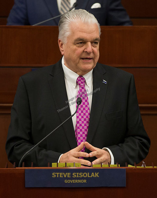 Nevada Governor Steve Sisolak delivers his first State of the State Address from the Assembly Chambers of the Nevada Legislature in Carson City, Nev., Wednesday, Jan. 16, 2019. (AP Photo/Tom R. Smedes)