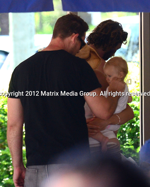 16 FEBRUARY 2013 SYDNEY AUSTRALIA ..EXCLUSIVE ..Aaron Jeffery pictured in Avalon on his Harley Davidson meeting up with his wife Zoe Naylor and baby....*No internet without clearance*.MUST CALL PRIOR TO USE ..+61 2 9211-1088.Matrix Media Group.Note: All editorial images subject to the following: For editorial use only. Additional clearance required for commercial, wireless, internet or promotional use.Images may not be altered or modified. Matrix Media Group makes no representations or warranties regarding names, trademarks or logos appearing in the images.