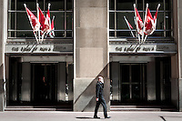 A man talking over his cellphone walks by a Bank of Nova Scotia offices in Toronto financial district April 19, 2010. The Bank of Nova Scotia,  commonly called Scotiabank in English and Banque Scotia in French, is the third largest bank in Canada by deposits and market capitalization.
