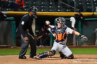 Tyler Heineman (22) of the Fresno Grizzlies and home plate umpire J.J. January during the game against the Salt Lake Bees in Pacific Coast League action at Smith's Ballpark on April 13, 2016 in Salt Lake City, Utah. The Grizzlies defeated the Bees 6-0. (Stephen Smith/Four Seam Images)