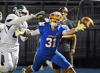 Springfield's Kyle Long (31) reaches for a pass as Ridley's (2) breaks up the play in the second quarter Thursday, September 28, 2017 in Springfield, Pennsylvania. (WILLIAM THOMAS CAIN / For The Philadelphia Inquirer)