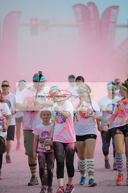 Pink decorates runners in the Color Run.  Photo for the Star by Michael Dinneen