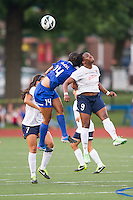 Boston Breakers defender Kia McNeill (14) and Sky Blue FC forward Danesha Adams (9) leap for a high ball.  In a National Women's Soccer League Elite (NWSL) match, Sky Blue FC defeated the Boston Breakers, 3-2, at Dilboy Stadium on June 16, 2013