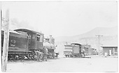 RGS #12 being inspected at Placerville depot while it has extra flags on the tender indicating a reverse move.  Another C-16 is just ahead.<br /> RGS  Placerville, CO  ca. 1910-1915