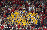 spt-asuua 112910226tmk -- A pocket of ASU' fans surrounded by Arizona fans celebrate ASU's second field goal of during the secod quarter of Thursday's Territorial Cup in Tucson.  (Pat Shannahan/ The Arizona Republic(