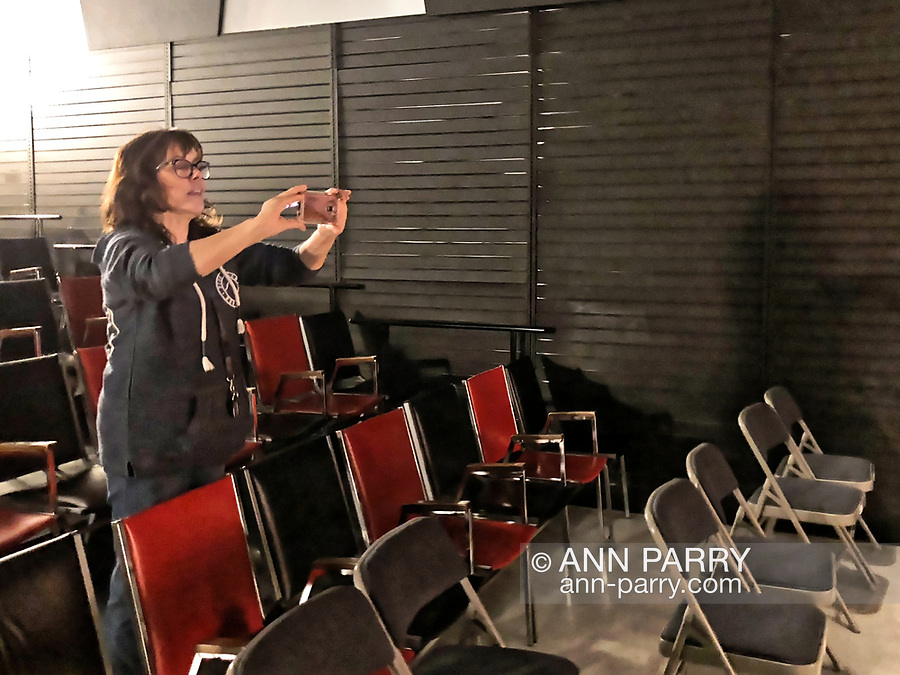 Lindenhurst, New York, USA. September 23, 2018. Deborah Plezia, the Artistic Director of South Shore Theatre Experience, takes photos of performers and staff on stage after the Comedy Magic Show presented by The Parlor of Mystery.