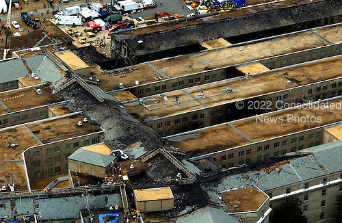 This aerial photograph of the Pentagon in Washington, D.C. taken on Friday, September 14, 2001, shows some of the destruction caused when the high-jacked American Airlines flight slammed into the building on September 11, 2001.  The terrorist attack caused extensive damage to the west face of the building and followed similar attacks on the twin towers of the World Trade Center in New York City.  .Credit: Department of Defense via CNP.
