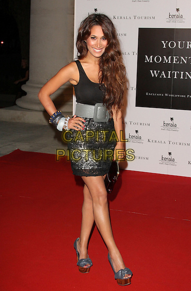 PREEYA KALIDAS .Your Moment Is Waiting - launch party at Saatchi Gallery, London, England..September 21st 2010.full length black top grey gray belt silver skirt hand on hip platform shoes bracelets .CAP/ROS.©Steve Ross/Capital Pictures