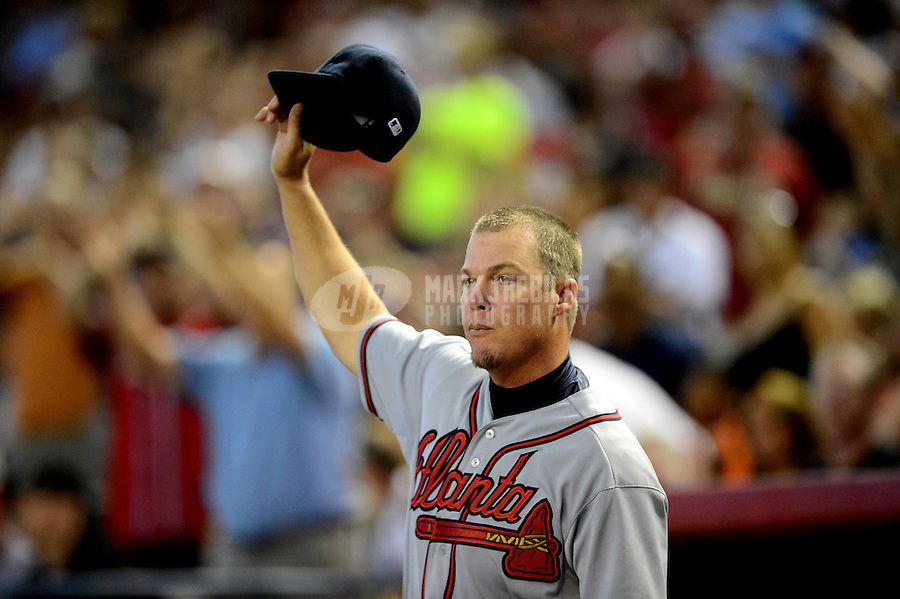 Apr. 22, 2012; Phoenix, AZ, USA; Atlanta Braves third baseman Chipper Jones acknowledges the crowd during his last regular season game at Chase Field against the Arizona Diamondbacks.  Mandatory Credit: Mark J. Rebilas-