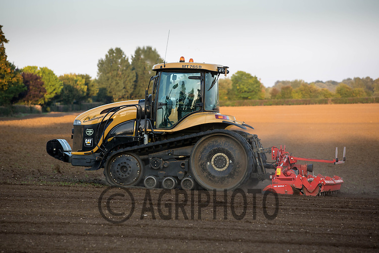 Cat Challenger with a power harrow working land before drilling with Winter Barley<br /> Picture Tim Scrivener 07850 303986