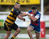 Joshua Gray looks to fend off Reece Joyce as he attacks the midfield. Counties Manukau Premier 1 McNamara Cup Final between Ardmore Marist and Bombay, played at Navigation Homes Stadium on Saturday July 20th 2019.<br />  Bombay won the McNamara Cup for the 5th time in 6 years, 33 - 18 after leading 14 - 10 at halftime.<br /> Photo by Richard Spranger.